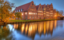 Historic brick buildings on Trave River. Stock Image