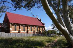 Australia: old brick church with gum tree - h Stock Photos