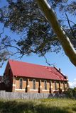 Australia: old brick church with gum tree Royalty Free Stock Photography
