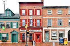 Historic Brick Main Street Buildings. Historic brick merchant buildings including a bank and insurance agency in Newburyport, Massachusetts, New England Royalty Free Stock Images