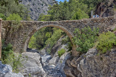 Historic Bridge. A large stone bridge over a mountain river Stock Image