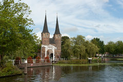 Historic bridge, Oostpoort Delft. Delft Tower bridge and Oostpoort on water Royalty Free Stock Photography