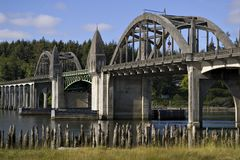 Historic bridge over Siuslaw River Florence Oregon. Beautiful historic bridge over the Siuslaw River in Florence Oregon Royalty Free Stock Photos