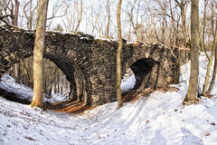 Historic bridge over the valley filled with snow Royalty Free Stock Photo