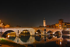 Historic roman bridge lighted at night Royalty Free Stock Photography