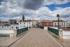 Historic bridge in Tavira city Stock Images