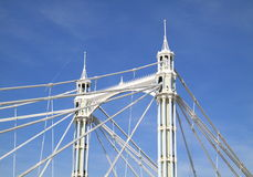 Historic bridge towers. Octagonal cast iron towers of Albert Bridge over the River Thames in London between Chelsea on the north bank and Battersea on the south Royalty Free Stock Photo