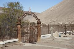 Cemetery in the Atacama Desert, Chile. Historic British Cemetery from the era of nitrate mining in the Atacama Desert, in the grounds of Hacienda Tiliviche in Royalty Free Stock Photography
