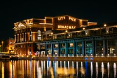 The historic Broadway Pier at night, in Fells Point, Baltimore, Maryland.  royalty free stock photo