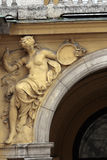 Historic building facade decoration. Sculpture of the naked woman on the old building entrance Stock Photography