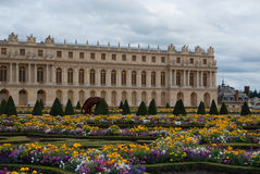 Historic building. Garden of a historic building French, lush flowers Royalty Free Stock Photo