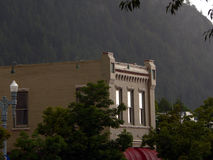 Historic building in Aspen, Colorado. Sun breaks through the rain clouds to shine on an old Aspen, Colorado building Stock Photo