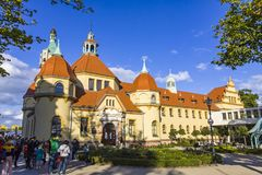 Historic Building of Balneology Institute in Sopot, Poland. SOPOT, POLAND - JULY 31, 2015: Historic Building of Balneology Institute and old Lighthouse on the Royalty Free Stock Photography