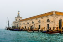 Historic building and a big Sailing boat at venice docks photo taken from `vaporetto royalty free stock photos