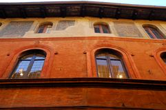 Historic building elegant and colorful red in Bologna in Emilia Romagna (Italy) Royalty Free Stock Photos