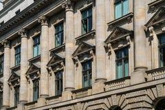 Historic building facade with columns. Windows on historic building facade with columns - historic building facade with columns Royalty Free Stock Photo