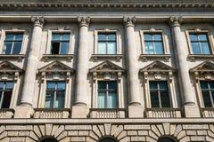 Historic building facade with columns. Windows on historic building facade with columns Stock Photography