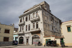 Historic building in Havana. Historic building on the street of Havana with motorcycles and the people in the foreground Royalty Free Stock Photo