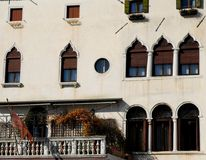 Historic building illuminated by the sun with 8 beautiful windows in Venice Italy Stock Image