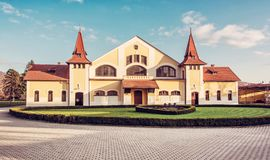Historic building of national stud farm, retro filter. Historic building of national stud farm, Topolcianky, Slovak republic. Architectural theme. Travel stock image