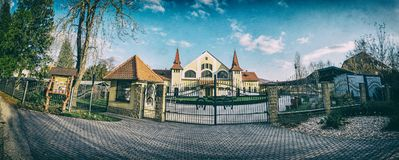 Historic building of national stud farm, Topolcianky. Slovak republic. Architectural theme. Analog photo filter with scratches. Panoramic photo royalty free stock image