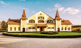 Historic building of national stud farm, Topolcianky. Slovak republic. Architectural theme. Travel destination. Yellow photo filter royalty free stock photography