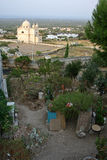 Historic building in ostuni, italy. A garden near an historic building in ostuni italy Royalty Free Stock Images