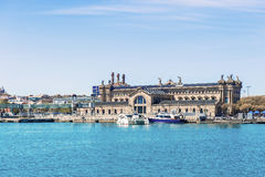 Historic building in Port Vell in Barcelona, Spain. Royalty Free Stock Photo