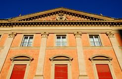Historic building with red curtains in the city center in Bologna in Emilia Romagna (Italy) Stock Photo