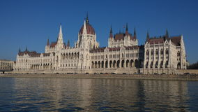 Historic building on river bank Royalty Free Stock Photography