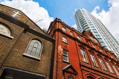 Historic building and skyscraper in Aldgate, London, UK Stock Images