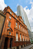 Historic building and skyscraper in Aldgate, London, UK Stock Photos
