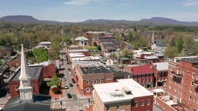 Historic Buildings Aerial Perspective Lexington Virginia USA. The downtown city center urban area of historic Lexington VA United States stock footage