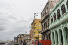 Historic buildings along the Malecon in Havana Cuba. Historic buildings line the Malecon in Havana under thick cloud cover Royalty Free Stock Photo