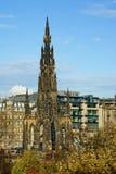 Scott Monument in Princes Street Gardens, in Edinburgh, Scotland. Historic buildings behind the Scott Monument in Princes Street Gardens in autumn, in Edinburgh stock image