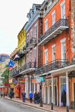 Historic buildings on Bourbon Street in French Quarter at early night stock images