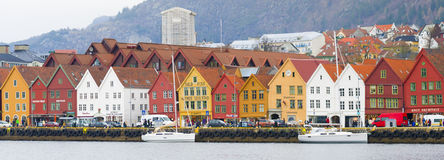 Historic Buildings, Bryggen, Bergen Norway. Colorful, old wooden buildings line the street in an area known as Bryggen, running along Vagen Harbor in the port Stock Photography