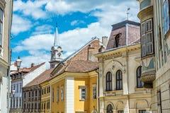 Historic buildings in Sopron, Hungary. Historic buildings and church tower in Sopron, Hungary. Architectural theme. Street scene stock image