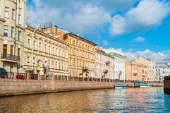 Historic buildings and embankment of Moika river in sunny day in Saint Petersburg, Russia Royalty Free Stock Images