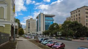 Historic buildings and hotels on independence avenue near Freedom Square in Kharkov timelapse hyperlapse, Ukraine. Traffic on the road and car parking stock footage
