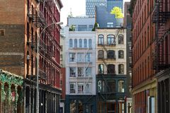Historic buildings at the intersection of Crosby and Howard Street in the SOHO neighborhood of Manhattan, New York City NYC stock photos