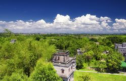 Kaiping tower Diaolou village buildings. The historic buildings of Kaiping Diaolou in Zili village in Kaiping China in Guangdong province on a sunny blue sky day royalty free stock image