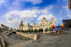 Historic buildings at the Liverpool Waterfront. LIVERPOOL, UK - AUGUST 18, 2016: Famous architecture at the waterfront in Liverpool, England. Fish eye royalty free stock image