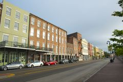 N Peters Street in French Quarter, New Orleans. Historic Buildings on North Peters Street between Bienville Street and Iberville Street in French Quarter in New Royalty Free Stock Image