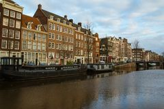 Historic buildings over the canals in the Old Town of Amsterdam. Netherlands stock images