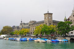 Historic buildings and parked boats beside the river in Zurich Stock Photo