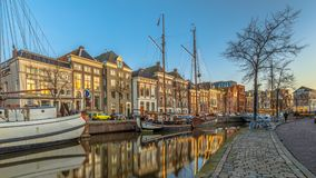 Historic buildings on Quay with ship. Historic buildings on Hoge der Aa Quay with ship in Groningen city centre at sunset, Netherlands Stock Image