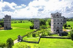 Kaiping tower Diaolou village buildings. The historic buildings and a rice paddy at Kaiping Diaolou in Zili village in Kaiping China in Guangdong province on a stock photos