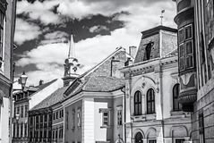 Historic buildings in Sopron, Hungary, colorless. Historic buildings and church tower in Sopron, Hungary. Architectural theme. Street scene. Black and white stock images