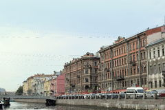 The historic buildings of St. Petersburg. The view from the canal on the construction of the 19th century stock photos